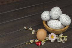 Painted eggs as a symbol of spring and new life on a wooden background. Stock Images