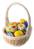 Painted eggs in the basket. On a white background Royalty Free Stock Images
