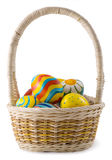 Painted eggs in the basket. Easter, colored eggs in a wicker basket on a white background Royalty Free Stock Image