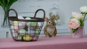 Painted eggs in a basket and Easter bunny stock video footage
