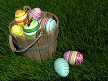 Painted eggs at Easter. High resolution 3D rendering of many easter painted eggs in a bucket on the grass Stock Photography