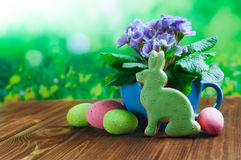 Painted eggs, Easter bunny gingerbread and primrose flower over Stock Image