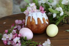 Painted eggs and easter cake on a wooden table. Still life with Easter cakes, painted eggs and flowers. Easter cake and eggs. Easter composition. Easter cake and royalty free stock photos
