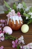Painted eggs and easter cake on a wooden table. Still life with Easter cakes, painted eggs and flowers. Easter cake and eggs. Easter composition. Easter cake and royalty free stock image