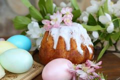 Painted eggs and easter cake on a wooden table. Still life with Easter cakes, painted eggs and flowers. Easter cake and eggs. Easter composition. Easter cake and stock images