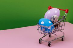 Painted eggs, for Easter celebration in a cart. With space for text Stock Image