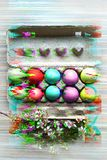 Painted eggs in egg tray. Glitch effect. Spring holiday. Holiday celebration, preparation. Egg hunt. Flower. Healthy and happy stock images