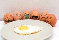 Painted eggs near omelette Royalty Free Stock Photography