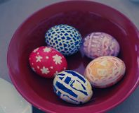 Painted eggs on plate royalty free stock images