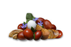 Painted eggs with sweet pastries and delicate flower periwinkle Stock Images