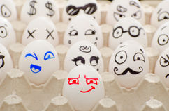 Painted eggs in tray, smiles, winks, Poirot Stock Image