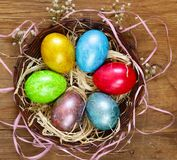 Painted eggs in a wicker basket Royalty Free Stock Photos