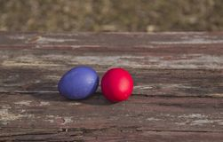 Painted eggs on a wooden table stock photos
