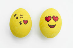 Painted emoji easter eggs in different moods and facial expressions such as kissing, smiling or being in love, in isolated white. Painted emoji easter eggs in stock photography