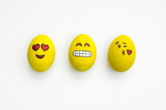Painted emoji easter eggs in different moods and facial expressi. Ons such as kissing, smiling or being in love, in white background stock photo