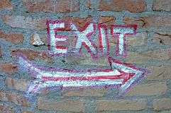 Painted exit sign on wall. Handmade painted exit sign on brick wall Stock Image