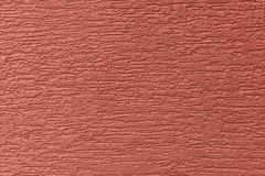 Painted facade wall. Building with structural red color paint Stock Photo