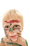 Painted face. Child's face painted by his brother after they managed to get hold of some enamel paint Royalty Free Stock Photo