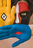 Painted face. Young man with colorful painted face, conceptual Royalty Free Stock Photography