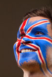 Painted face with English Flag. Football fan with a big smile on blackbaground Royalty Free Stock Photos