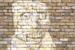 Painted face on wall. Horrific face painted on rough wall Royalty Free Stock Photography
