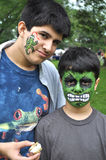 Painted Faces. Two Hispanic boys are enjoying a summer fair with painted funny faces stock photos