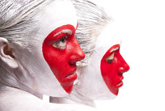 Painted faces delivering red heart pattern Stock Images