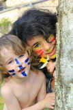 Face Painting. Young boy and girl with painted faces Stock Image