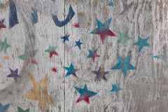 Painted fence panel. Colorful stars painted on to a wooden hoarding Stock Photos