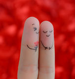 Painted finger smiley on red background Stock Photography