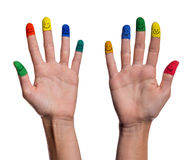 Painted fingertips with smileys. Painted fingertips of womans hands with smileys royalty free stock photos