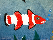 A painted fish on the wall up close with bubbles stock photography