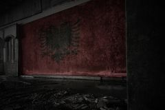 Painted flag of albania on the dirty old wall in an abandoned ruined house. Concept royalty free stock images