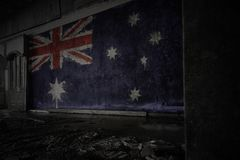Painted flag of australia on the dirty old wall in an abandoned ruined house. Concept royalty free stock image
