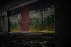 Painted flag of central african republic on the dirty old wall in an abandoned ruined house. Concept stock photography
