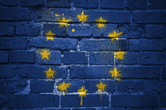 Painted flag of european union on a brick wall. Colorful painted flag of european union on a old brick wall royalty free stock image