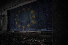 Painted flag of european union on the dirty old wall in an abandoned ruined house. Concept stock images