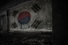 Painted flag of south korea on the dirty old wall in an abandoned ruined house. Concept royalty free stock photos
