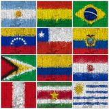 Painted Flags of South America. At the cracked wall Stock Photo