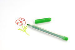 Painted flower and green felt-tip pen Stock Photo