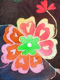 Painted flower on silk fabric Stock Image