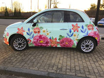 Painted flowers on small car Royalty Free Stock Photo