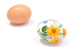 Painted and fresh eggs on white background Royalty Free Stock Photography