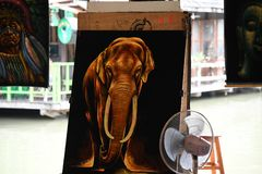 Painted gallery photographs at pattaya floating market. Elephant and green trees painted photographs at pattaya floating market stock photos