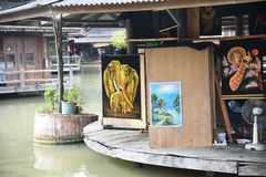 Painted gallery photographs at pattaya floating market. Elephant and green trees painted photographs at pattaya floating market royalty free stock photography