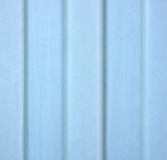 Painted galvanized steel siding. A close view of painted blue galvanized steel siding showing wear Royalty Free Stock Photo