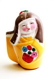 Painted Geisha Statuette. On white background Royalty Free Stock Photography
