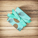 Painted gift box with ribbon, birthday theme Royalty Free Stock Photo