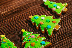 Painted gingerbread Christmas tree on a wooden background.  Royalty Free Stock Image