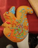 Painted gingerbread. Decorated with colored glaze cake in the shape of squirrels Stock Images